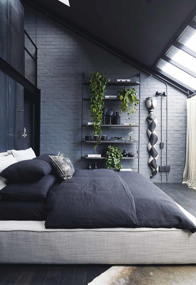 bedroom idea for men with grey brick wall and plants