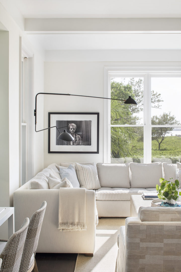 white living room with big windows