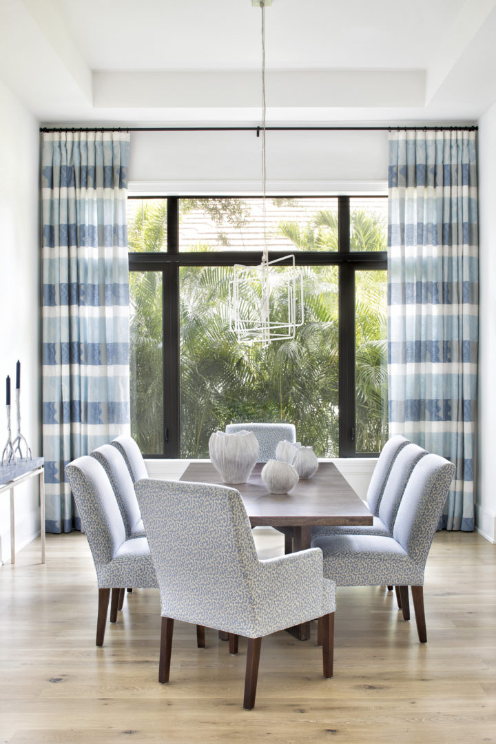 dining room with a big window for a coastal modern home