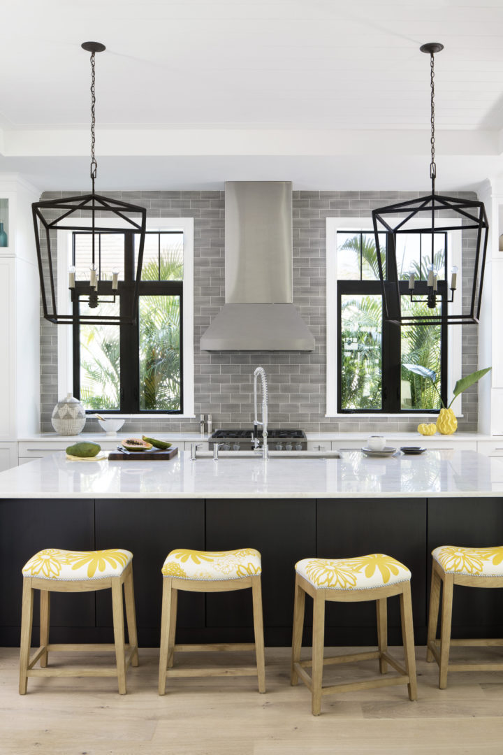 coastal modern kitchen with yellow stools