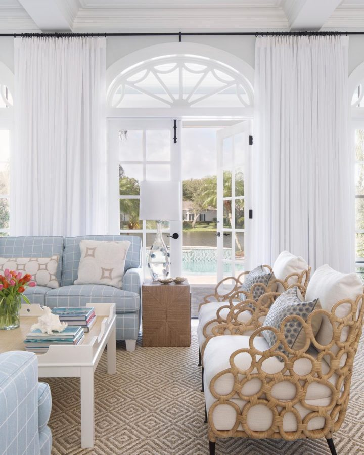 arched windows and pastel hues for coastal modern homes