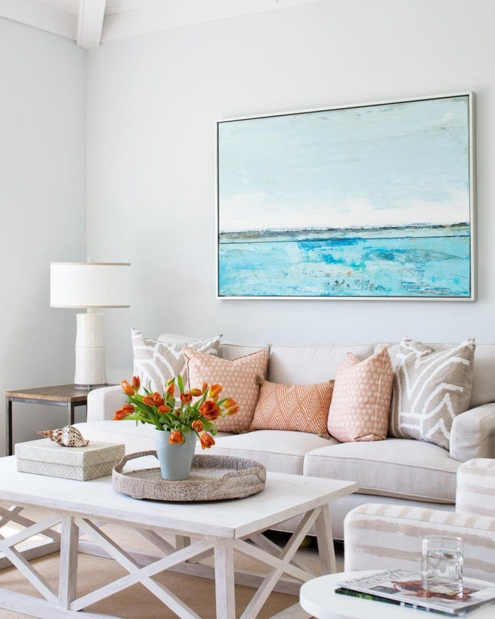 living room with a big sea picture on the wall