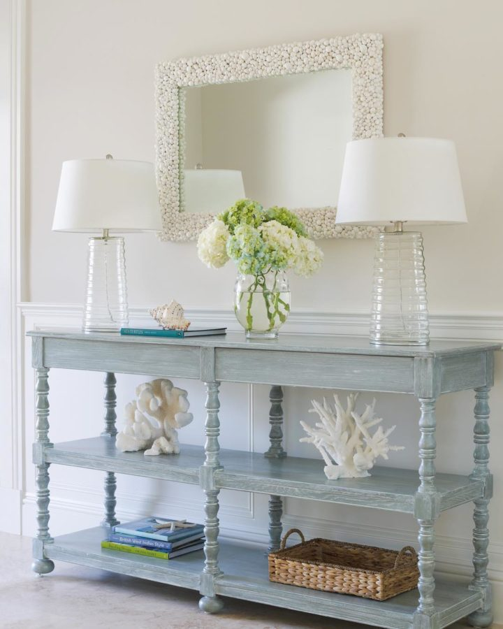 white and light blue decor with mirror