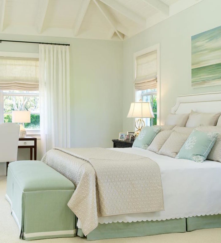 light teal bedroom with double bed