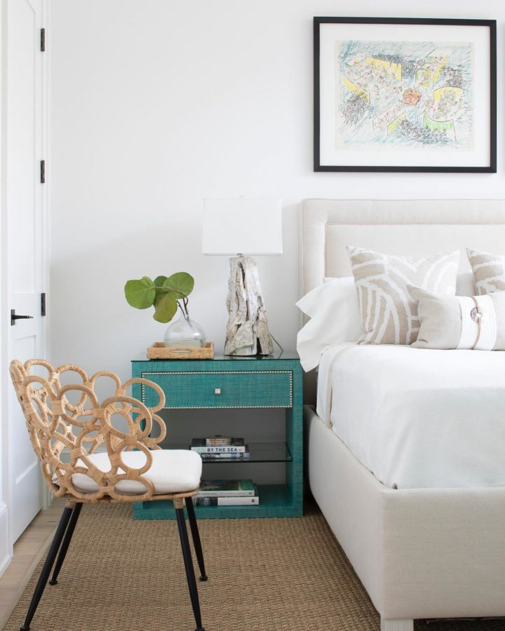 white bed and teal bedside table as coastal modern interior