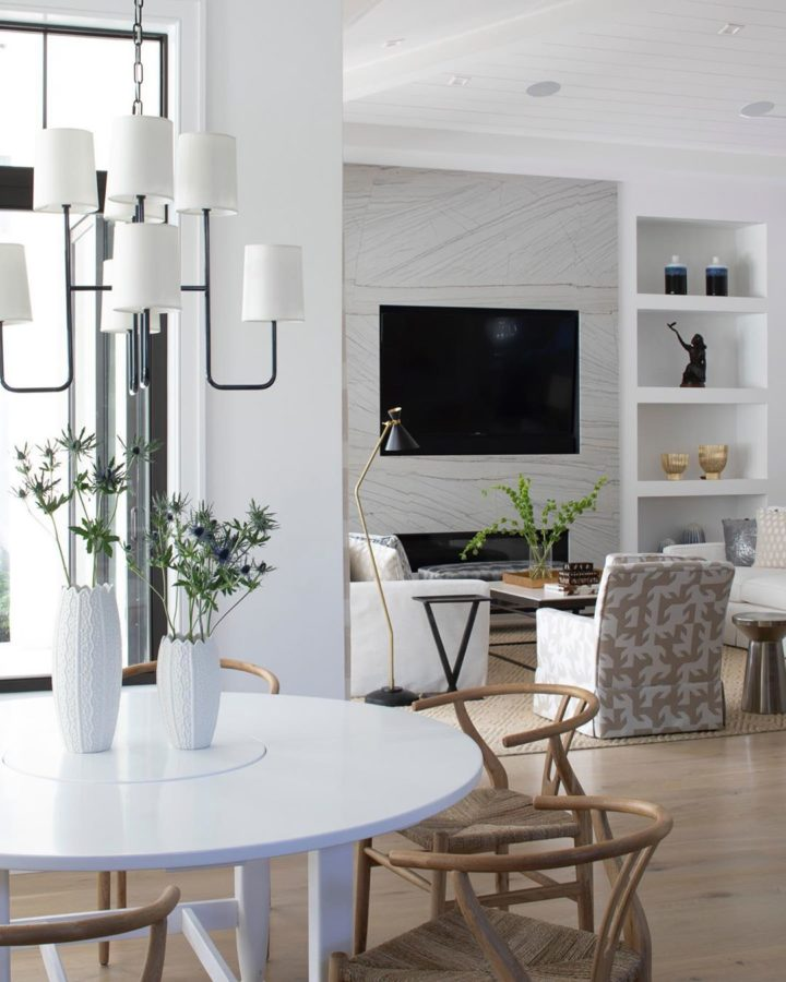 white coastal home interior with big TV