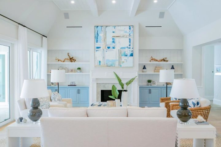 white and light blue living room with open shelves