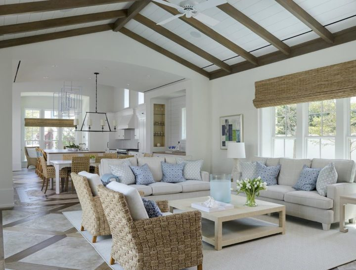 coastal modern home with exposed beams and big sofas