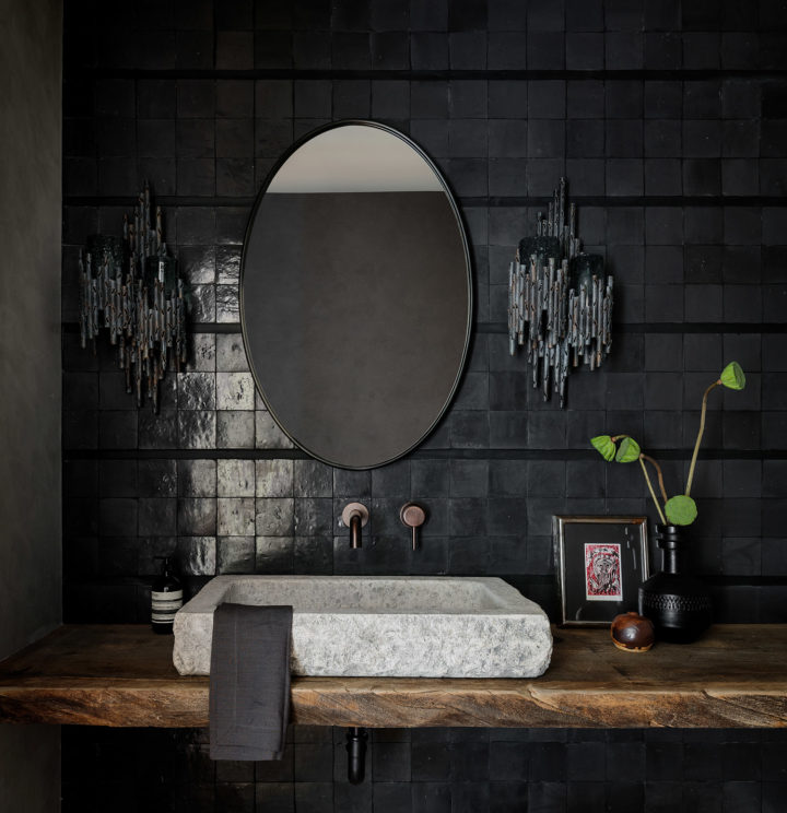 oval mirror in bathroom vanity for laid back luxury