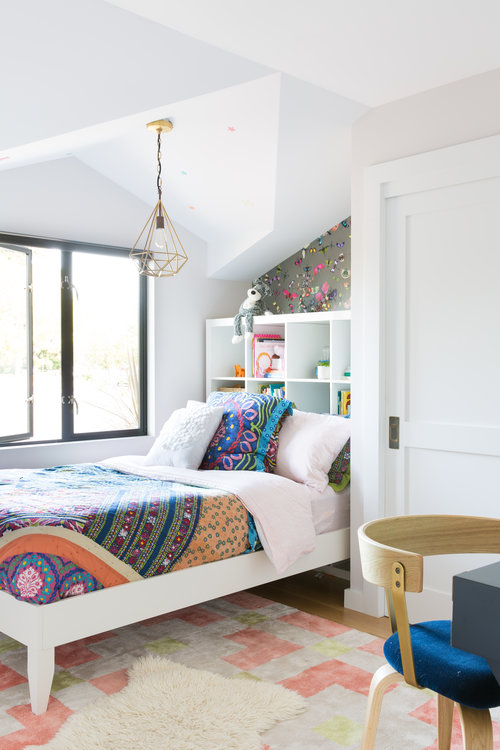 white bedroom walls with colorful bedding set