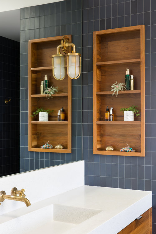 dark grey tiles and wooden in-wall shelves