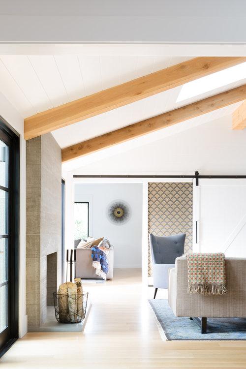 exposed beams in  interior with parque flooring