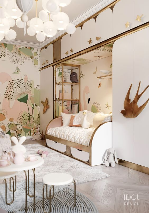 flowers and birds painted on the wall  with a cute little bed for girls