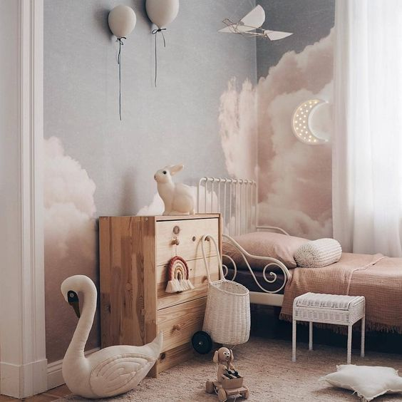 clouds painted on the walls and bunny, balloons, a moon and a swan