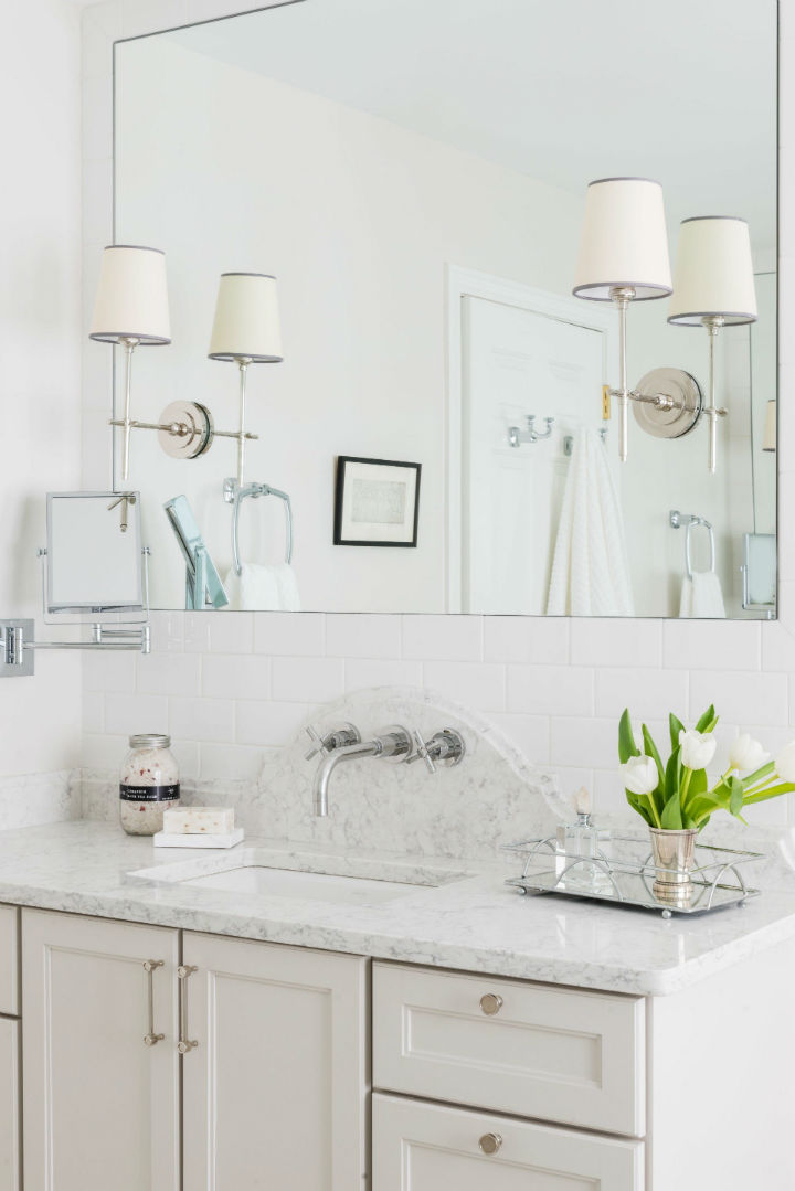 White bathroom with big square mirror