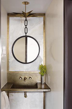eclectic modern interior with round mirror