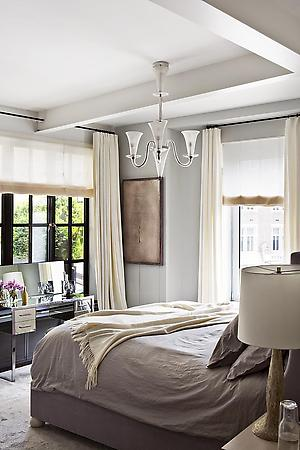 white bedroom with pastel colors and a double bed