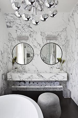 bathroom vanity with two round mirrors