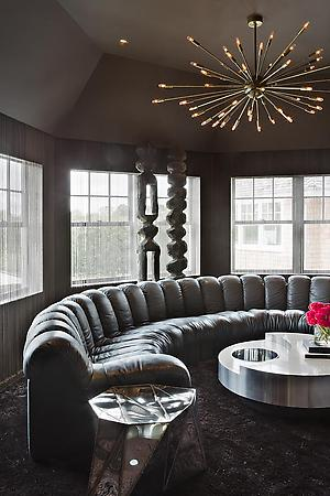 round sofa and a special chandelier hanging