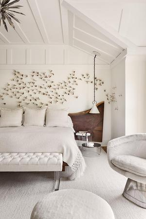 white bedroom with special design in the background