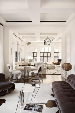 white interior with dark furniture
