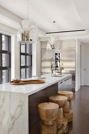 kitchen with marble island in eclectic interior