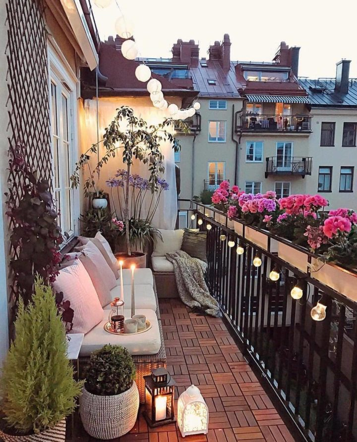 small balcony with decorative lighting  and plants
