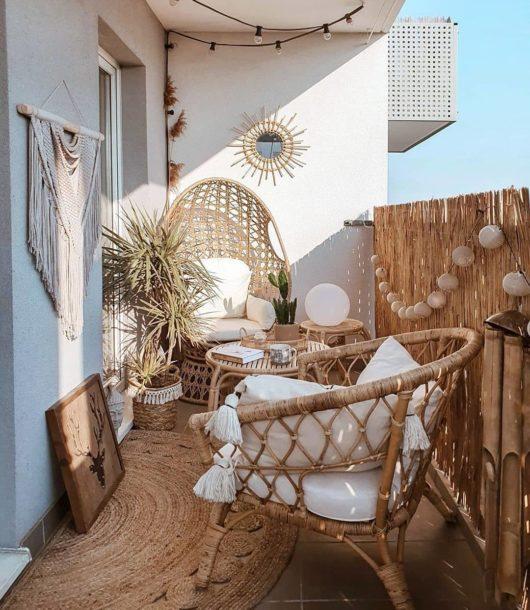 small boho balcony with rattan furniture