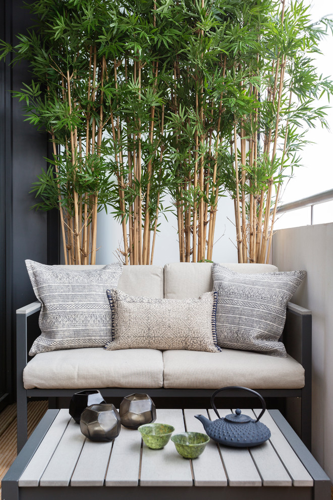 balcony trees with a small sofa as a sitting area