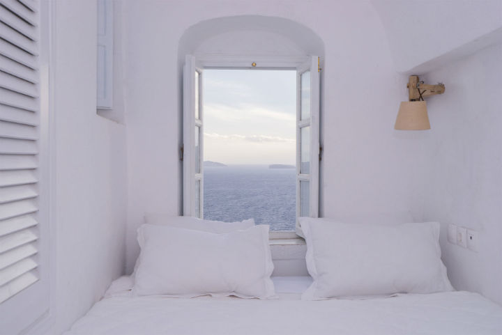 simple white bedroom with sea view