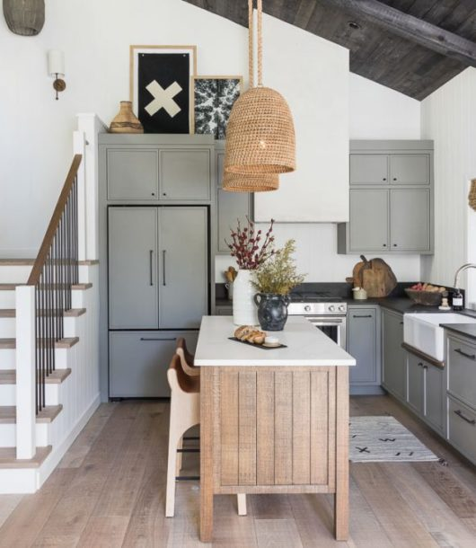modern country grey kitchen with small island with 2 wood tools