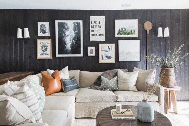 small living room with beige sectional sofa black wall and art gallery