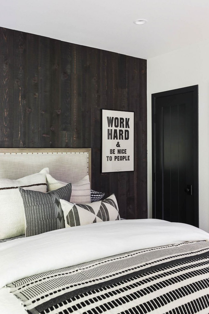 bedroom with dark wall and work hard & be nice to people quote wall decoration