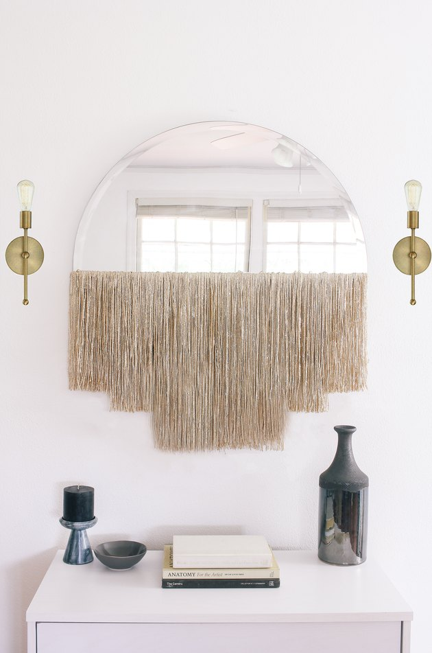 Fringed Mirror entry wall decorating idea
