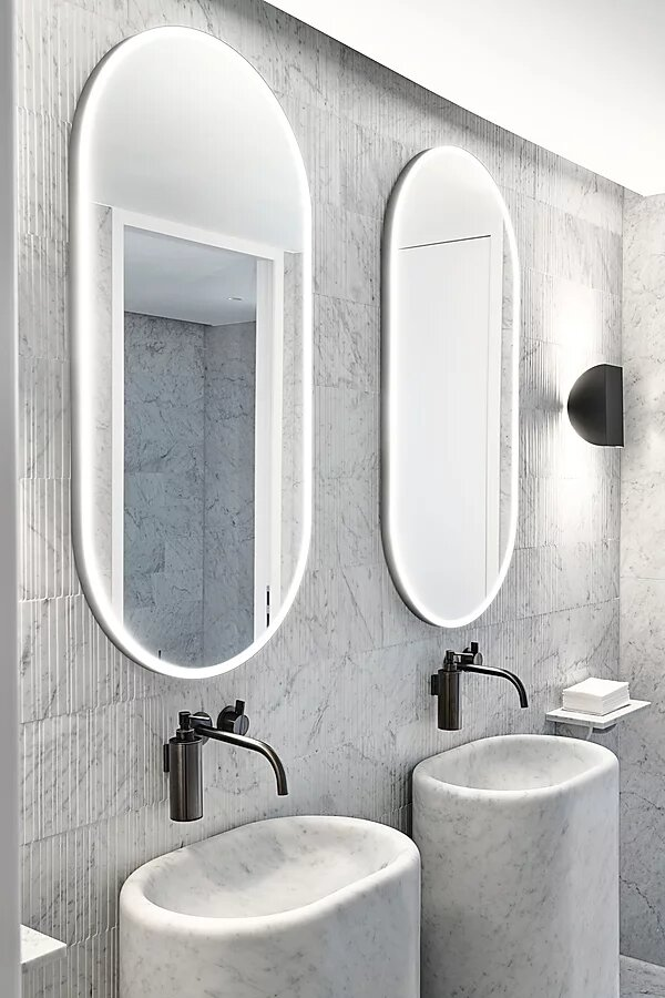 marble bathroom basins and two mirrors