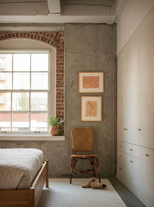 bedroom with concrete and brick wall pearl loft