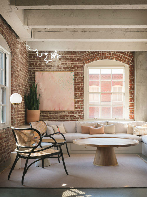 modern living room with sectional sofa brick walls and floor to ceiling white Double-Hung Windows With Munitions pearl loft