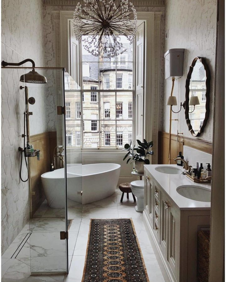 stylish white bathroom idea with large window bathtub and walk in shower and double sink