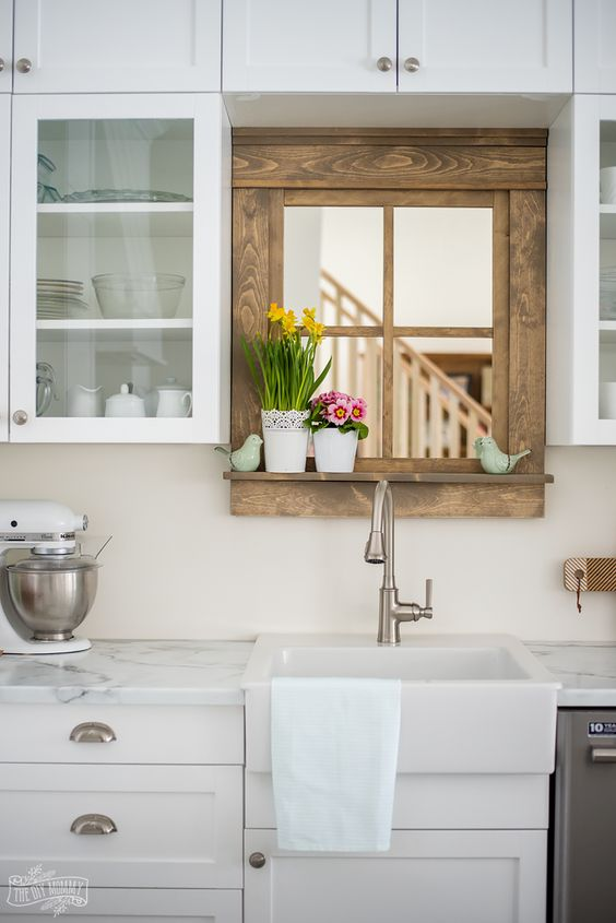 small wooden hunting mirror over kitchen sink