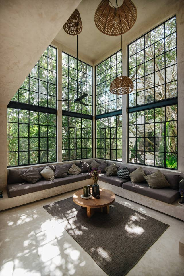 living room with muntin floor to ceiling windows