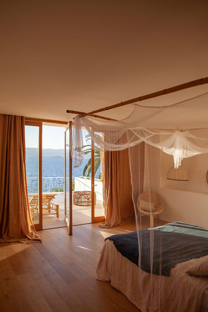 bed with canopy in a vacation villa