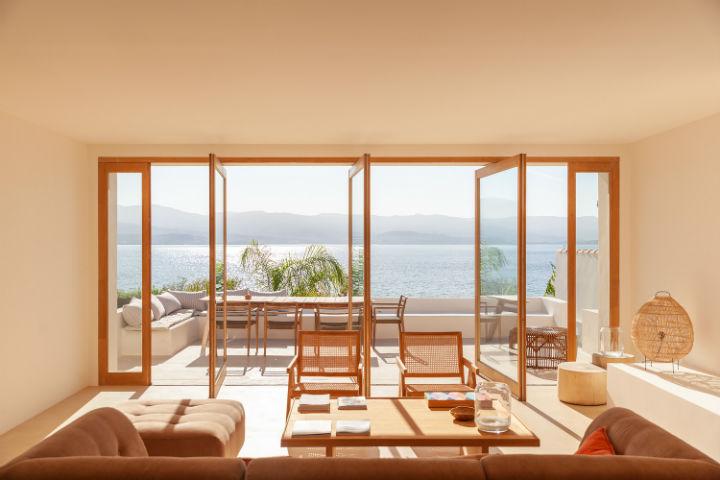 open door windows with a sea view in front