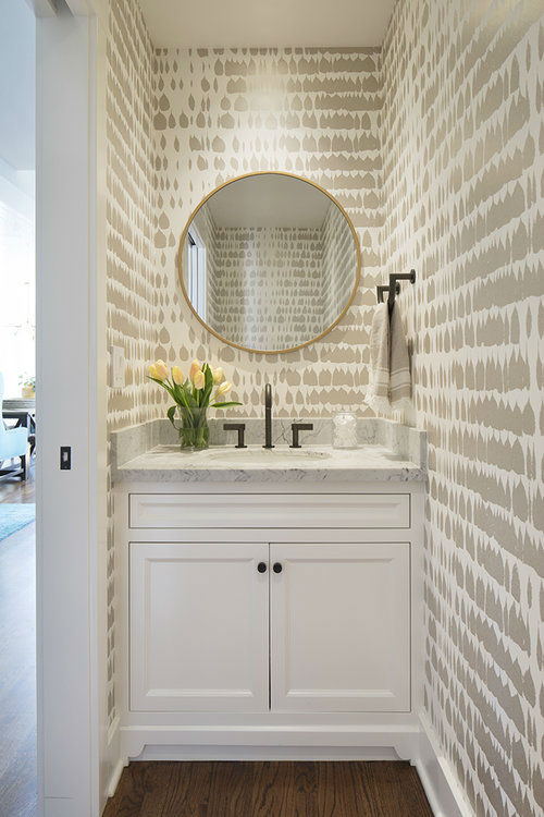 timeless chic white powder room with round mirror