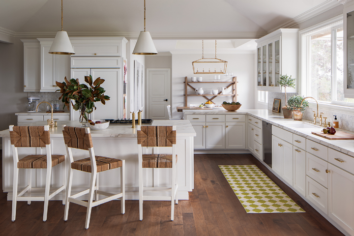 white kitchen with island and wood stools