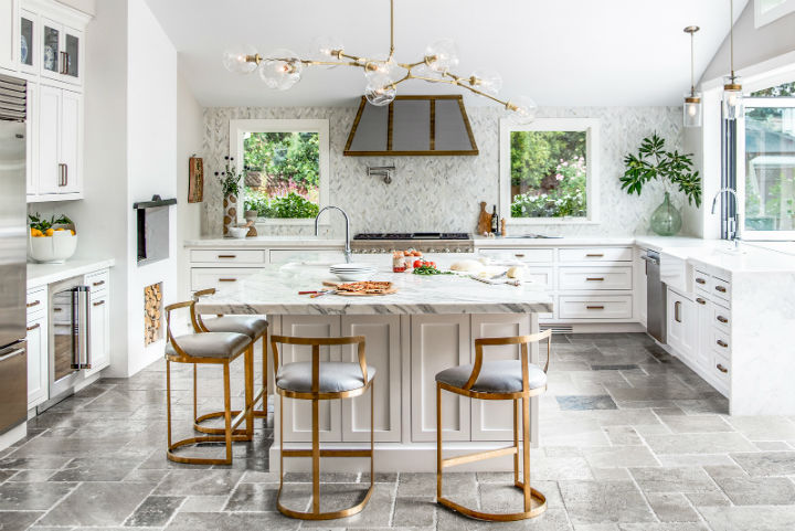 elegant white kitchen with island and gold stools