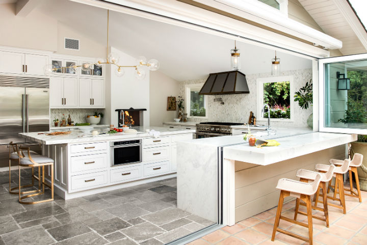 white kitchen with bar outside