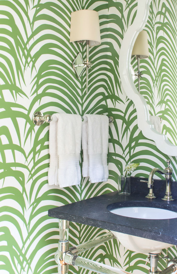 bathroom with green leaves wallpaper