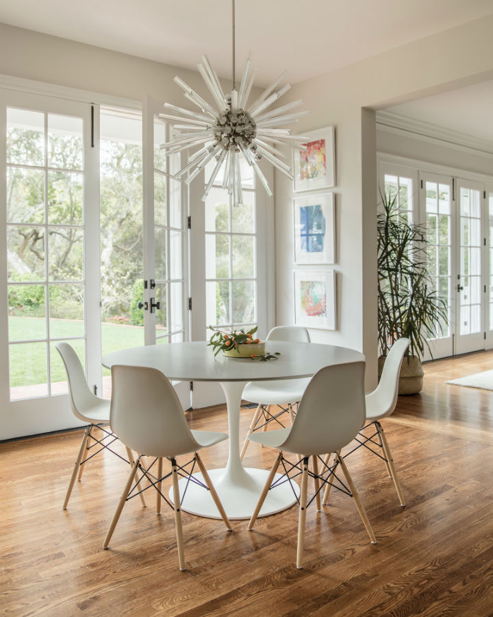 white dining room with round table