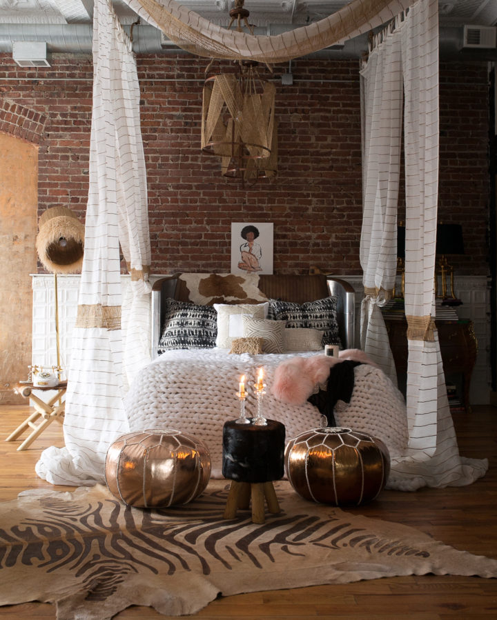 personal eclectic interior design style bedroom with brick walls
