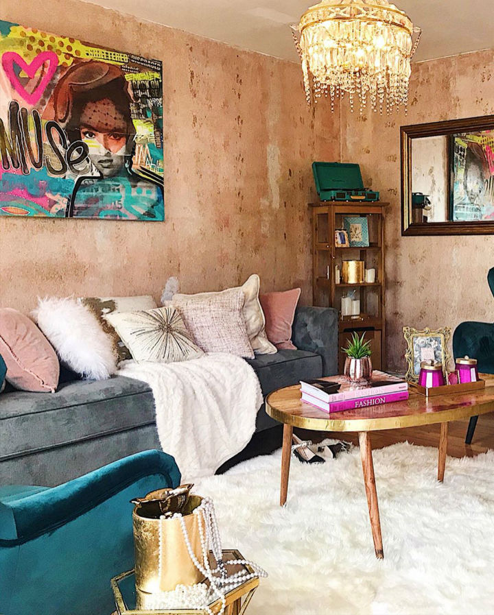 eclectic living room with pop art wall decor  and blue velvet sofa